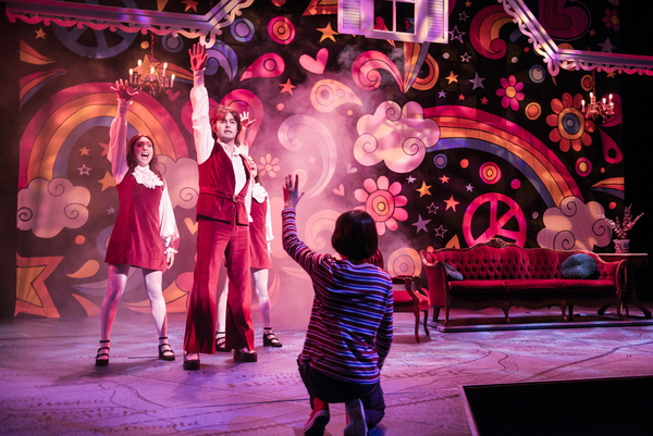 """Small Alison (foreground: Lila Gold) fantasizes about her favorite TV show coming to life in her living room, complete with singers and dancers (l to r: Ayelet Firstenberg, Michael Doppe, Erin Kommor) in """"Fun Home,�"""