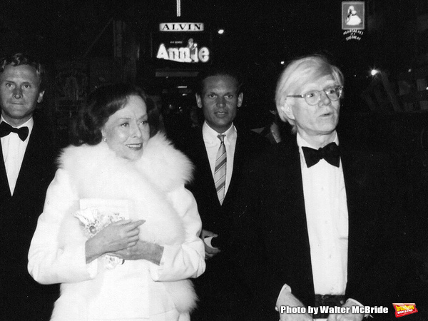 """Paulette Goddard and Andy Warhol after a performance of Broadway's """"Annie� at the Alvin Theatre in New York City. April 21, 1977"""