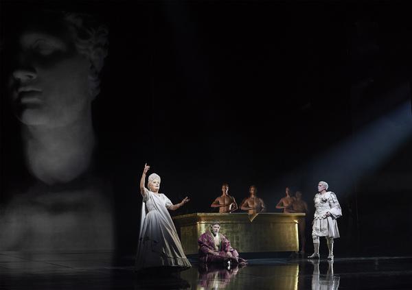 Karita Mattila as Plotina, Thomas Hampson as Hadrian (sitting), and Roger Honeywell a Photo