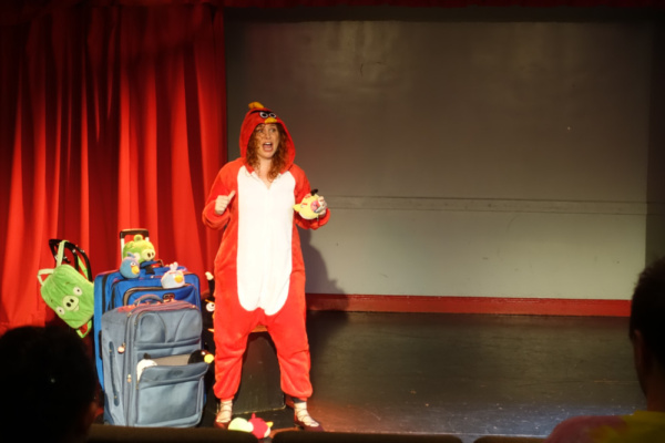 Dana Aber as Red Bird, singing BAD PIGGIES (music & lyrics by James Ballard in collaboration with Dana Aber), from Baggage at the Door.  photo: Justin Torres *Angry Birds is a trademark of Rovio En