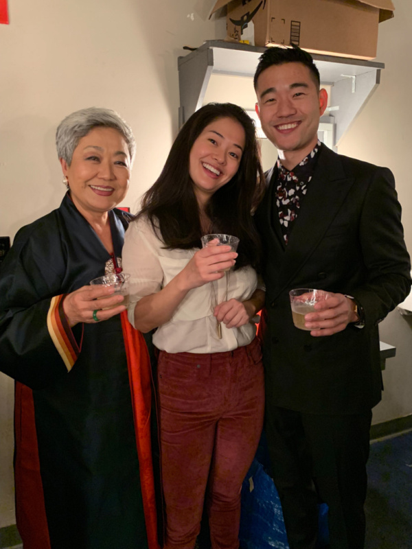 Esther Lee, Shannon Tyo and Daniel K. Issac share a toast backstage after opening night.