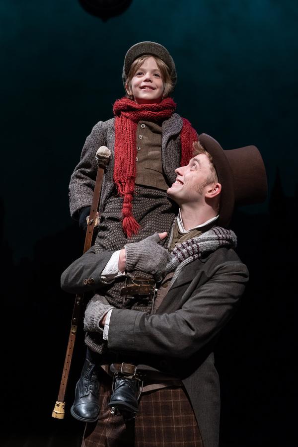 Aidan Fuller as Tiny Tim and Gregory Maheu as Bob Cratchi Photo