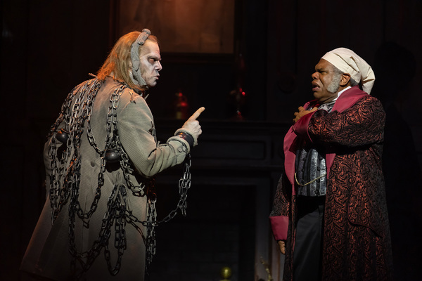 Stephen F. Schmidt as Jacob Marley and Craig Wallace as Ebenezer Scrooge Photo