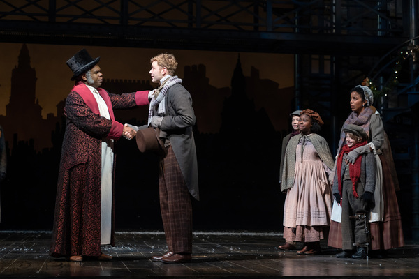 Craig Wallace as Ebenezer Scrooge, Gregory Maheu as Bob Cratchit, Yesenia Iglesias as Mrs. Cratchit and (children) Aidan Fuller, Madison K. Fields and Vaughn Mussmon