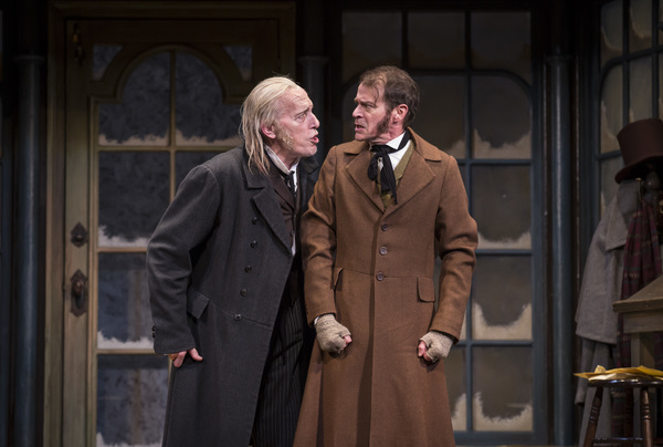 Larry Yando (Ebenezer Scrooge) and Thomas J. Cox (Bob Cratchit)