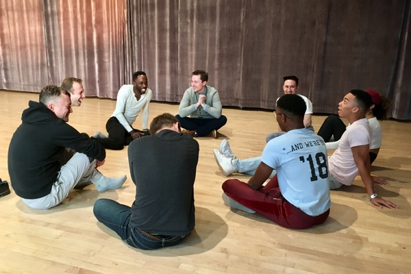 Choreographer Raja Feather Kelly and director Kevin Newbury have a rehearsal discussion with the Good Swimmer Choir: Jeremy Weiss, Sophia Byrd, Naseer Sleets, Joey LaPlante, Luke Bob Robinson, Papa Holt, and Kennedy Kanagawa. Photo by Cindy Sibilsky.