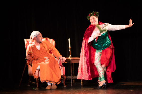 Scrooge (Eric Fletcher) and Ghost of Christmas Present (Kelsey Riker)  Photo: Martin Harris