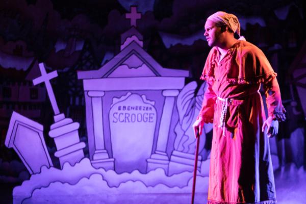 Scrooge (Eric Fletcher) at his grave  Photo: Martin Harris