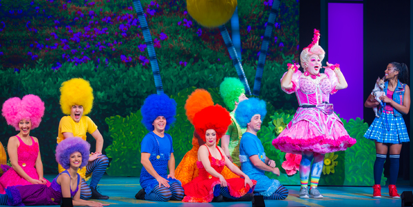 Michael De Rose as Sugarbum The Good Witch of the North (in pink), Camille Eanga-Selenge as Dorothy, and the Ozians. Photo by Racheal McCaig