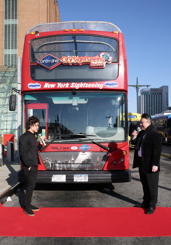NEW YORK, NEW YORK - DECEMBER 10: Shin Lim, America's Got Talent 2018 Winner and Star of Broadway's The Illusionists, speaks with David W. Chien, Creator and Producer at Ride of Fame, during the Ride Of Fame unveiling of his imminent seat, at Pier 78 on D