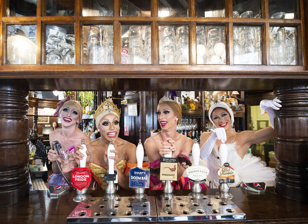 "The ""Trocks"" go bar-hopping. Eugenia Repelskii (Joshua Thake), Olga Supphozova (Rober Photo"