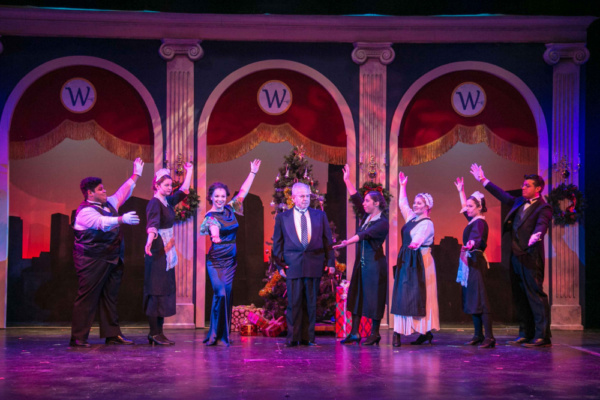 Tony Republicano as Oliver Warbucks, Sara Winant as Grace Farrell, and the ensemble of ANNIE, which plays at the Downtown Cabaret Theatre in Bridgeport, CT through December 30th.
