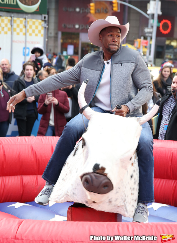 Photos: GMA DAY Host Michael Strahan Braves Mechanical Bull Ride In Times Square!