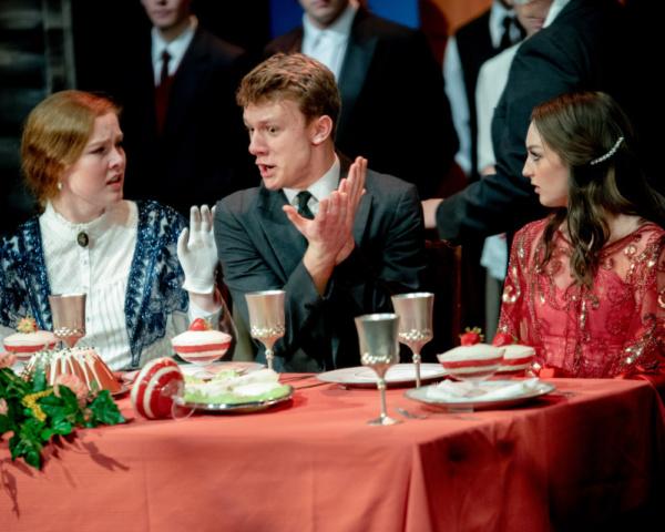 Ava Pirie as Phoebe D'Ysquith, Nick Brogan as Monty Navarro, and Leah Reineck as Sibella