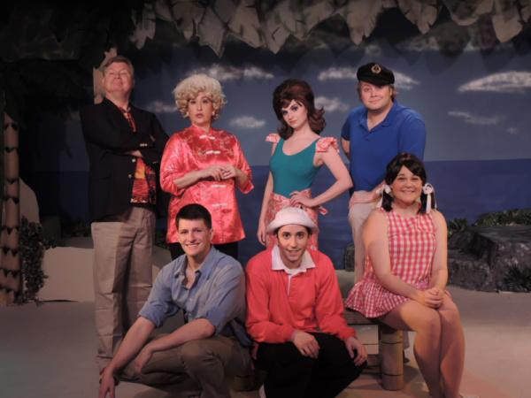 Front Row: Brandon Bedore as the Professor, Joseph Waeyaert as Gilligan, Megan E. West as Mary Ann; Back Row: Steve Steele as Thurstone Howell, Sarah Melinda as Lovey Howell, Alexis Krey as Ginger, and Jordan B. Stocksdale as Skipper
