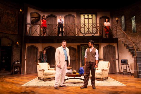 Jason O'Connell (Frederick Fellowes) and Gopal Divan (Lloyd Dallas), in foreground, in Noises Off at Two River Theater. Lower level: Ellen Harvey (Dotty Otley). Upper level: Adrianna Mitchell (Brooke Ashton), Michael Crane (Garry Lejeune), and Kathleen
