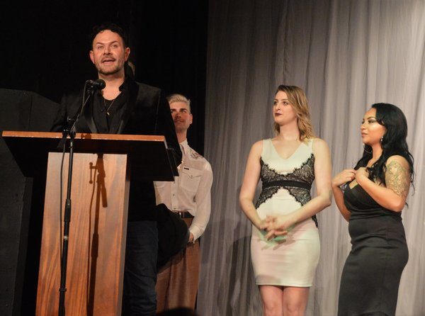 Matt Logan accepts the First Night Award for Outstanding Scenic Design (for Studio Tenn's FRANKENSTEIN) from Nicholas Ryan, Emily Maria Seifert and Kiana Schofill.