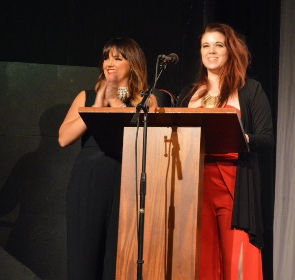 Rachel Potter and Angela Gimlin present the award for Outstanding Leading Actor in a Musical.