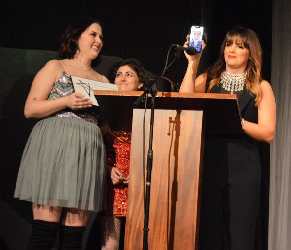 """Jenna Pryor, Molly Rocket and Rachel Potter, with Broadway Princess Party's """"fairy godfairy"""" and musical director Benjamin Rauhala on Facetime, accepting the award for Outstanding Road Show."""
