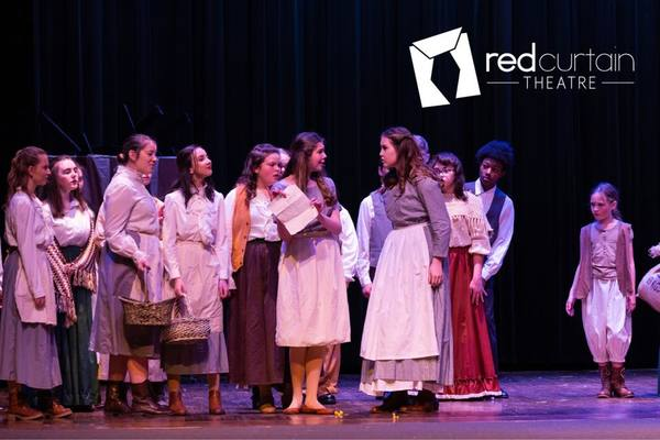 Factory worker (Emmarie Wilson) causes trouble for Fantine (Rylee Wills)