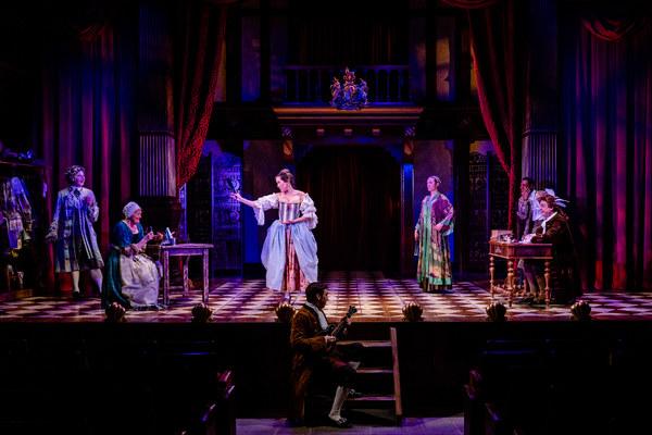 Orange seller Nell Gwynn (Alison Luff, center) addresses the King's Acting Company