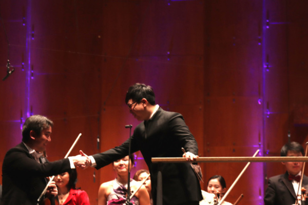 New York Philharmonic concertmaster Frank Huang and Singaporean conductor Kahchun Won Photo