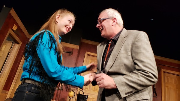Sarah Reed as Tammy-Jo Harper and W. Richard Johnson as Mr. Oakfield, the lawyer in Lone Star Love Potion
