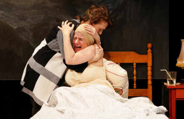 Jan Leslie Harding & Bernadette Quigley in DYING IN BOULDER. Photo by Carlos Cardona. Photo