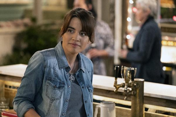 Natalie Morales as Abby Photo
