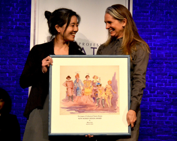 Mimi Lien accepting the Ruth Morley Award from Christine Jones.     Photo credit: Shoshana Medney