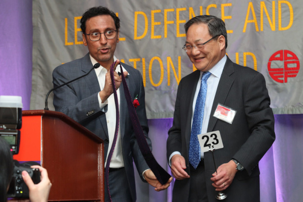 Aasif Mandvi with John G. Chou, General Counsel, AmerisourceBergen, who placed the wi Photo