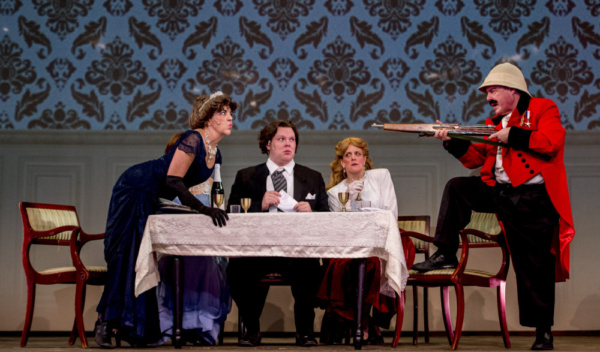 Lady Eugenia D''Ysquith (Justine Quirk) glares across the table at Lord Adalbert D''Ysquith (Edward Emmi) in the Milburn Stone Theatre?s production of ?A Gentleman?s Guide to Love & Murder? April 5-14,