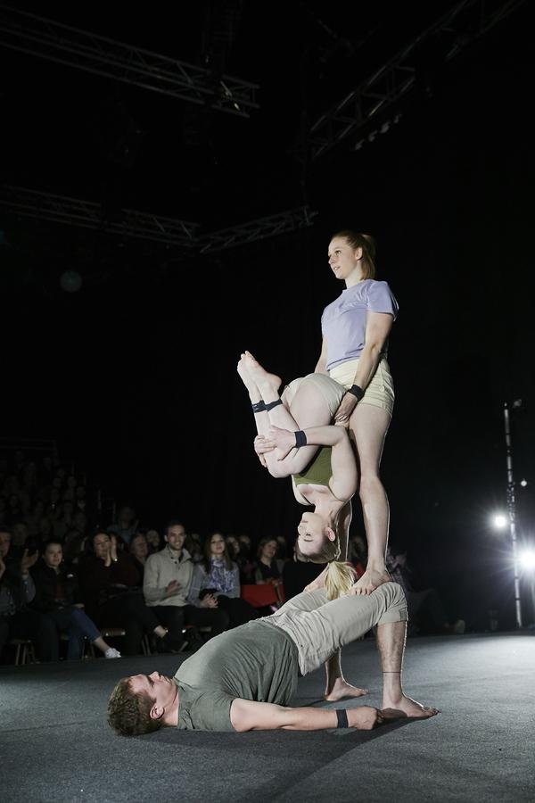 Benton Adams-Walker, with Lisa Goldsworthy (standing) and Ashleigh Pearce (upside-dow Photo