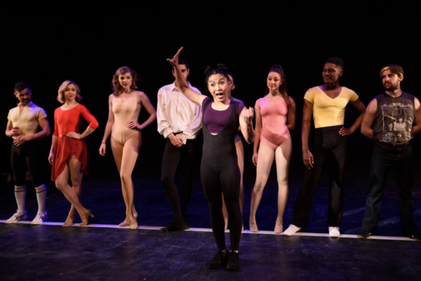 In front of the line Ayana Strutz as Connie Wong in A CHORUS LINE from Porchlight Music Theatre