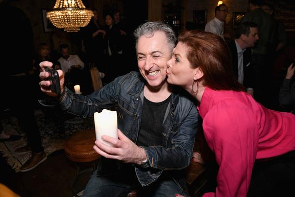 Alan Cumming and Debra Messing