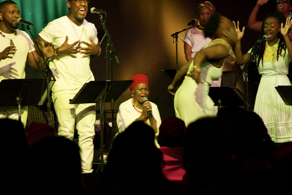 Tshidi Manye (center) performs with WiLDFLOWER cast