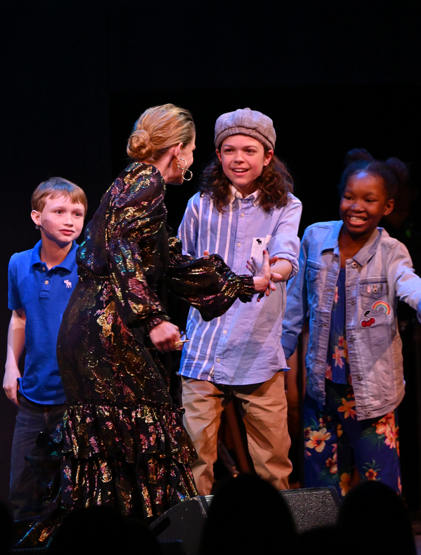 Anna Chlumsky greets the campers onstage  Photo