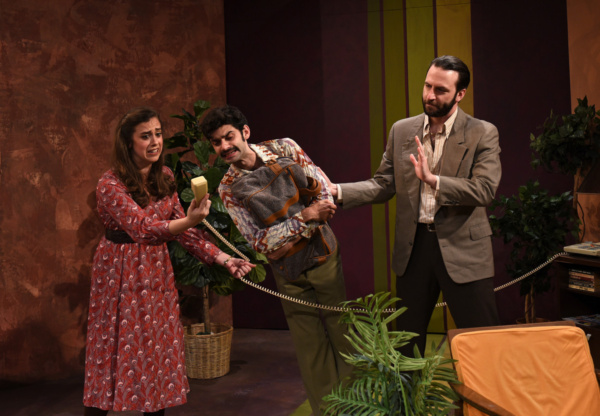 Prudence (Devi Reisenfeld), Bob (Siddhartha Rajan) and Bruce (Nick Freed) deal with Bob?s singing Mother on the phone in Eclipse Theatre''s production of ?Beyond Therapy? by Christopher Durang, directe