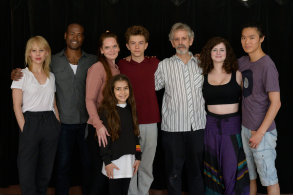 The full cast of ROUND WENT THE WHEEL. From left: Christina Toth, Rafael Jordan*, Marie Elena O''Brien*, Oriah Elgrabli (front), Coltrane Gilman, Michael Gnat*, Moira McAuliffe, and Victor Chen. (*Acto