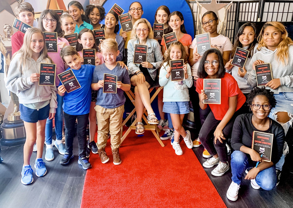 Young performers at camp participate in master classes with acting and casting profes Photo