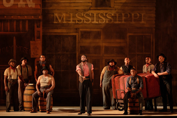 Justin Hopkins as Joe with members of the ensemble in The Glimmerglass Festival's 201 Photo