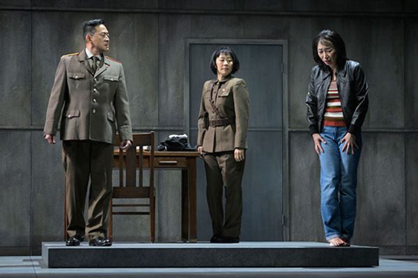 Paul Juhn (Official), Cindy Im (Soldier Two), and Jo Mei (Hanako) in the American pr Photo
