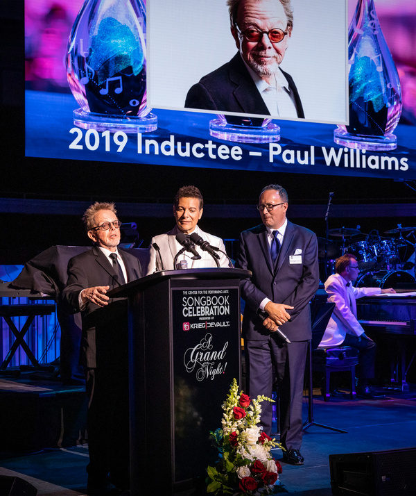 Paul Williams (left) is joined by Great American Songbook Foundation Founder Michael Feinstein and Executive Director Christopher Lewis as he is inducted into the Songbook Hall of Fame. The