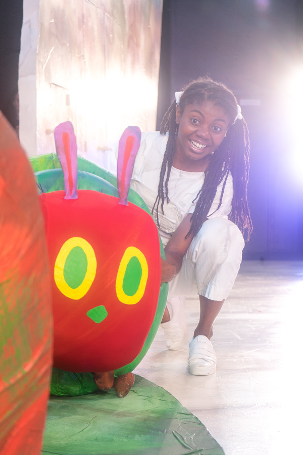 """Leslie Ann Sheppard with �""""The Very Hungry Caterpillar,"""" one of four Eric Carle stories included in The Very Hungry Caterpillar Show, Chicago Children's Theatre's 2019-20 season opener. Tickets and information: chicagochildrenstheatre.org or (312) 374-8835. Photo by Ari Craven"""