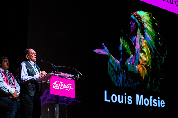 Center: Louis Mofsie accepting his 2019 Bessie for Outstanding Service to the Field o Photo