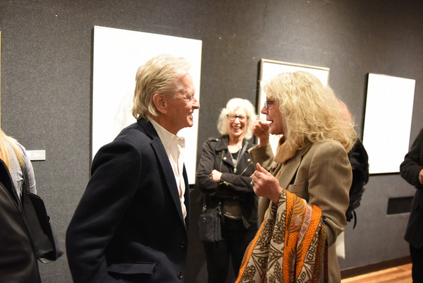 Actors Michael Douglas, Blythe Danner, and Cynthia Adler share a laugh during Joseph Feury''s Fioretti: Through the Window exhibit at the Nation Arts Club.