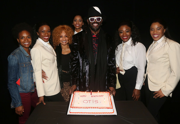 Otis Williams poses with the female cast members  Photo