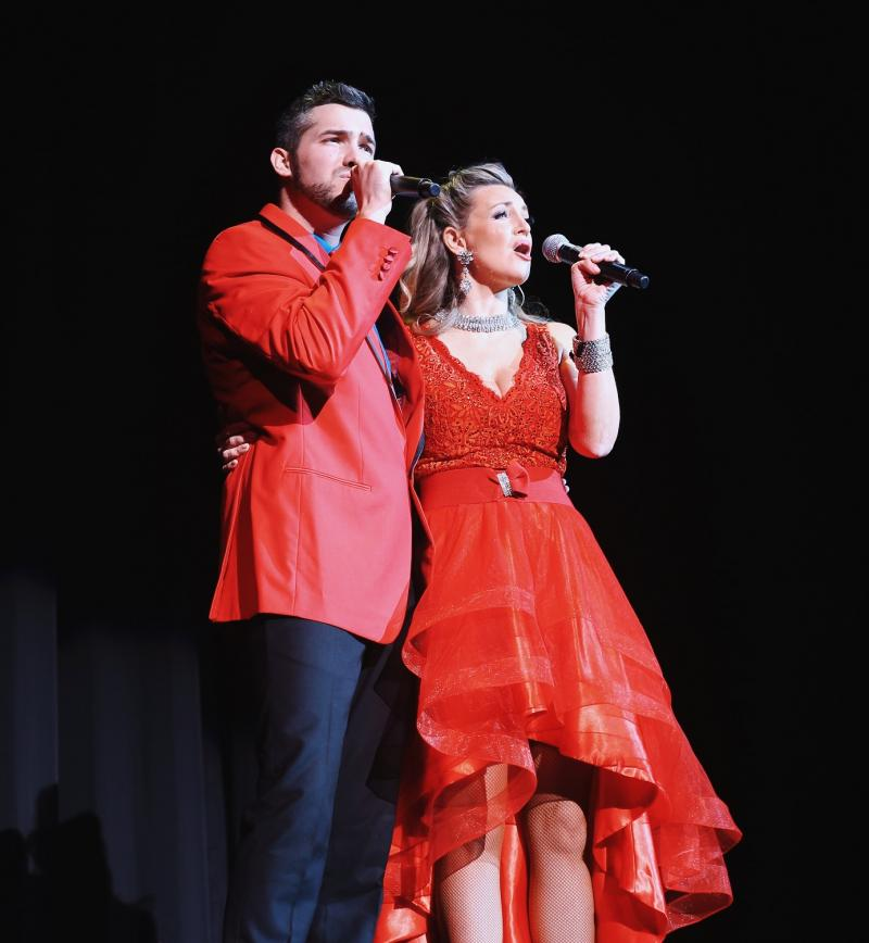 a male and a female singer onstage