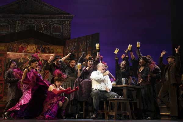 (center, seated) Adam Grupper as Alfred P. Doolittle and Company in The Lincoln Cente Photo