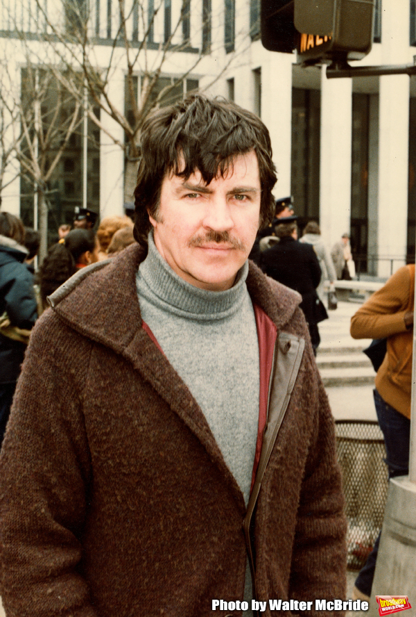Alan Bates walking on Fifth Avenue in New York City. April 1980. Photo
